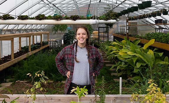 Tyree at the SD Farm greenhouse