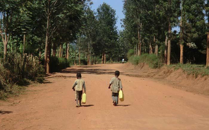 Rwandan boys carrying water