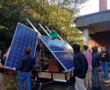 Students mount solar array