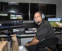 Wayne L. Sumner at WASU console