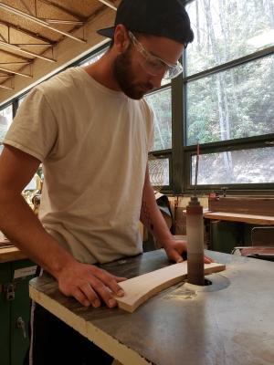 Sam Somerville works on his tea cabinet