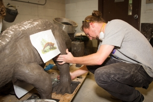 An art student works on the aetosaur