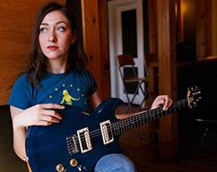 Alexa Rose with guitar