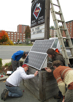 Graduate students and faculty build solar-powered sign lighting system