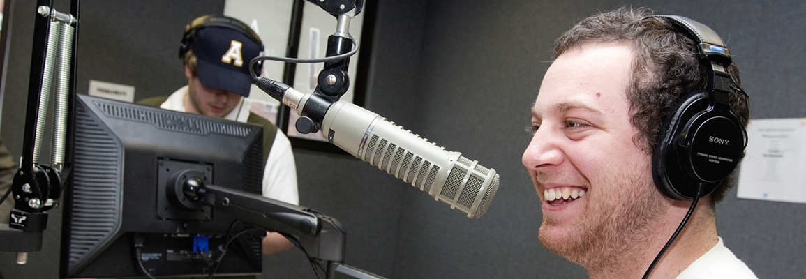 A communicaton student on air in the studio