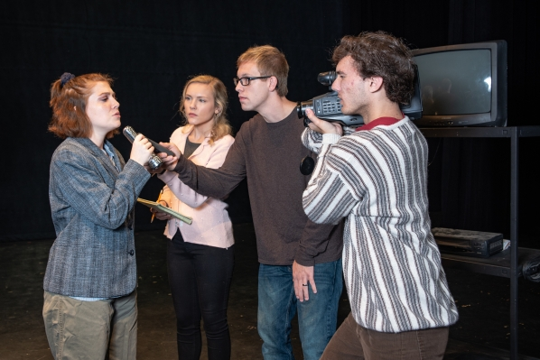 Four theatre students rehearse