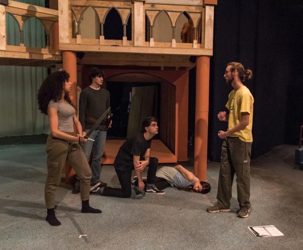 The cast rehearses