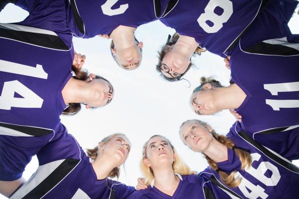 Girls in a soccer huddle