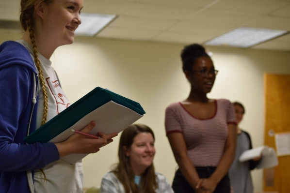 Three students rehearse for an upcoming performance.