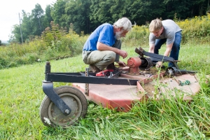 Student and faculty member work on the farm