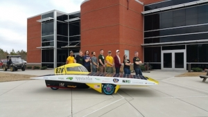 Members of the team with their solar vehicle