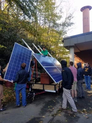 Students mount solar array