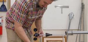 Brent Summerville works on wind measurement device