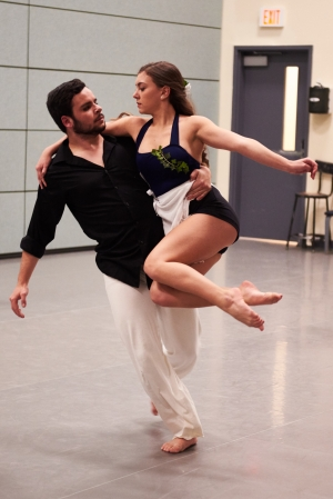 A male and female dancer perform