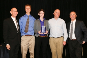 Appalachian State University was named a finalist in this year's Race to Zero competition. Pictured at an awards ceremony are Tom Kenney, left, director of the Housing Innovation Research Lab, Appalachian graduate students Brad Painting, Lena Burkett and Chase Ambler, and Sam Rashkin, chief architect of the U.S. Department of Energy's Building Technologies Office. (Photo submitted)