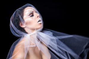 Photograph of woman in a veil.