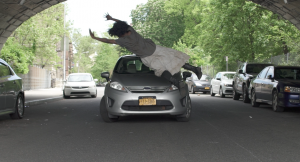 Woman jumping in front of a car